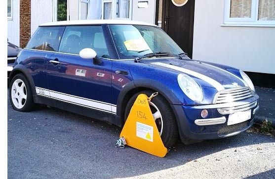 A wheel clamped car - unpaid vehicle tax penalty